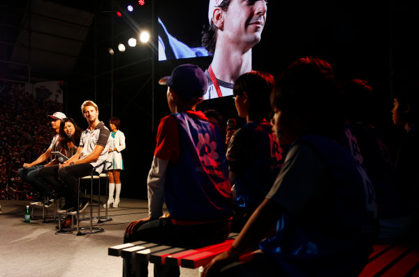 Suzuka Circuit, Japan. Saturday 08 October 2016. Romain Grosjean, Haas F1, and Esteban Gutierrez, Haas F1, answer questions from children at a fan event. World Copyright: Andy Hone/LAT Photographic ref: Digital Image _ONZ4802
