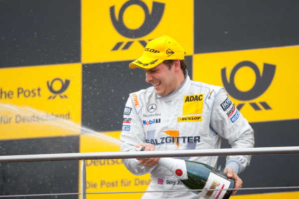 Dijon - Prenois, France. Sunday 11th October. Gary Paffett (Salzgitter AMG Mercedes C-Klasse) celebrates his victory on the podium. World Copyright: Alastair Staley/LAT Photographic.Ref: _O9T0709 jpg
