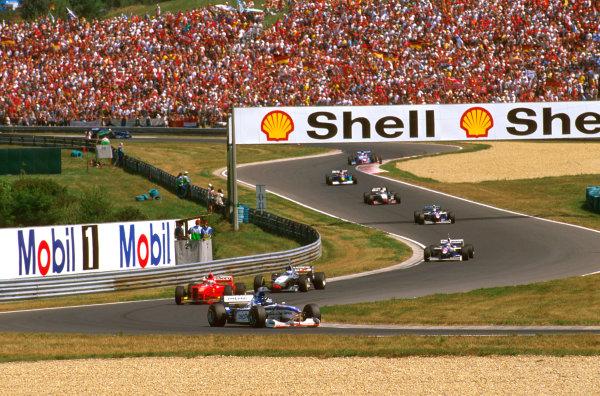 Hungaroring, Hungary.8-10 August 1997.Damon Hill (Arrows A18 Yamaha) at Turn 12, followed by Eddie Irvine (Ferrari F310B) and Mika Hakkinen (McLaren MP4/12 Mercedes).Ref-97 HUN 16.World  Copyright - LAT Photographic