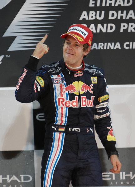 Yas Marina Circuit, Abu Dhabi, United Arab Emirates 1st November 2009. Sebastian Vettel, Red Bull Racing RB5 Renault, 1st position, celebrates victory on the podium. Portrait. Podium.  World Copyright: Steve Etherington/LAT Photographic ref: Digital Image SNE17958