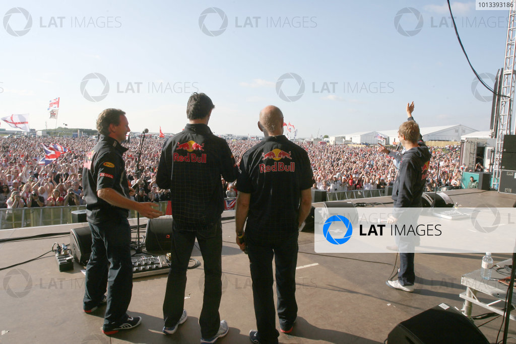 Silverstone, Northamptonshire, England21st June 2009Race winner Sebastian Vettel on stage at the party with team mate Mark Webber, Red Bull Racing RB5 Renault, Christian Horner, Team Principal, Red Bull Racing and Adrian Newey, Chief Technical Officer, Red Bull Technology.World Copyright: Jakob Ebrey/LAT Photographicref: Digital Image JE__2649