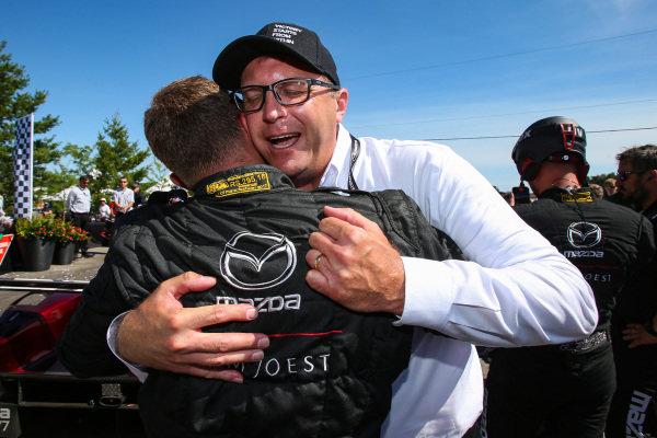 Mazdas Director of Motorsport, John Doonan celebrates another Mazda 1-2 victory