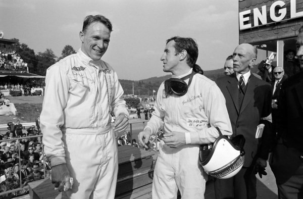 Dan Gurney, 1st position, with Jackie Stewart, 2nd position, on the podium.