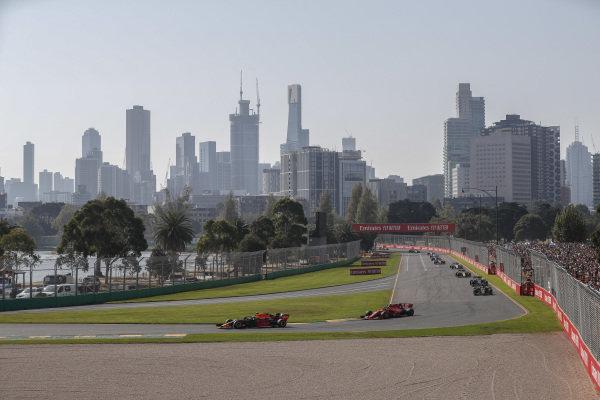 Max Verstappen, Red Bull Racing RB15, leads Charles Leclerc, Ferrari SF90, Kevin Magnussen, Haas VF-19, Romain Grosjean, Haas VF-19, and Nico Hulkenberg, Renault R.S. 19
