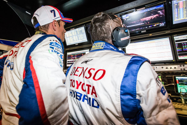 Stéphane Sarrazin watches the last moments of qualifying at the Toyota Racing pit wall