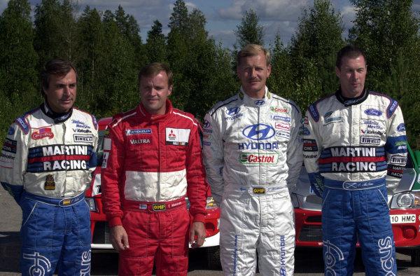 2001 World Rally Championship.Neste Rally Finland. Jyvaskyla, August 24-26, 2001.The four Champions bidding to make a historical 24th WRC victory, L-R: Carlos Sainz, Tommi Makinen, Juha Kankkunen and Colin McRae.Photo: Ralph Hardwick/LAT