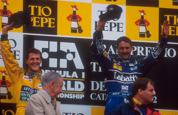 1992 Spanish Grand Prix.Catalunya, Barcelona, Spain.1-3 May 1992.Nigel Mansell (Williams Renault) 1st position and Michael Schumacher (Benetton Ford) 2nd position on the podium.Ref-92 ESP 01.World Copyright - LAT Photographic