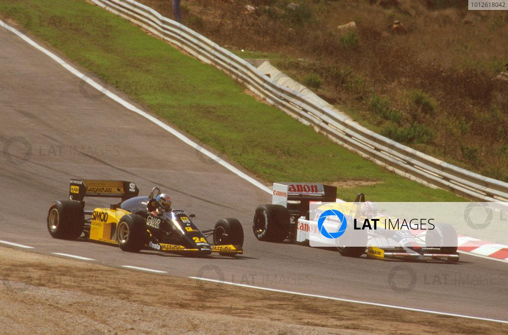 Estoril, Portugal.19-21 September 1986.Nigel Mansell (Williams FW11 Honda) 1st position, laps Alessandro Nannini (Minardi M185B Motori Moderni).Ref-86 POR 01.World Copyright - LAT Photographic