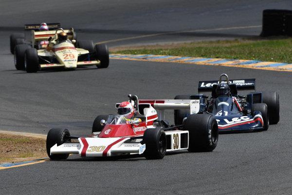 Danny Baker, McLaren M23, 1976 leads Ron Maydon, LEC CRP1, 1977