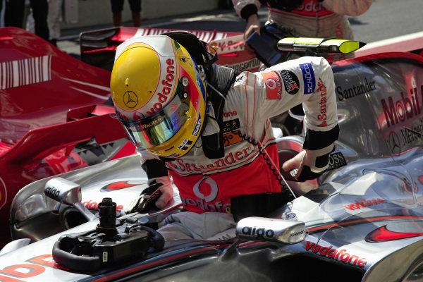 Lewis Hamilton climbs out of his McLaren MP4-22 Mercedes in parc fermé.