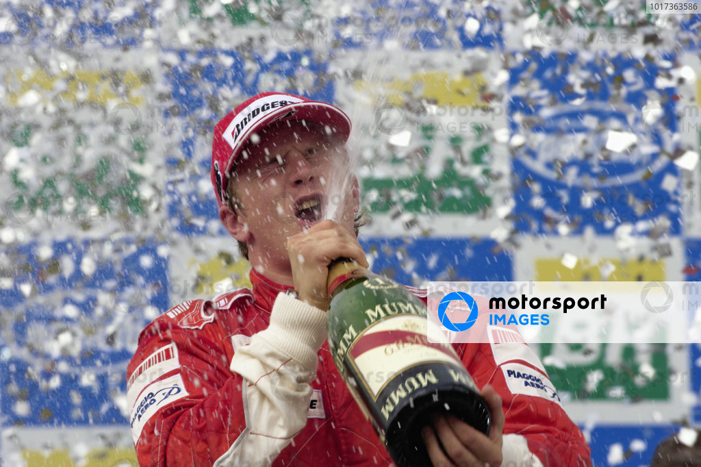 Kimi Räikkönen celebrates race victory and his drivers' championship with a champagne shower.