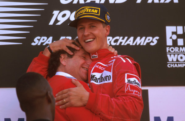 Spa-Francorchamps, Belgium.23-25 August 1996.Michael Schumacher (Ferrari) 1st position celebrates on the podium with team boss Jean Todt.Ref-96 BEL 02.World Copyright - LAT Photographic