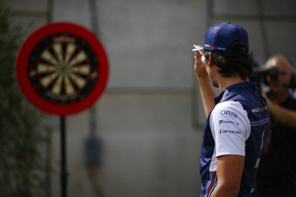 Lance Stroll, Williams Racing, plays darts.