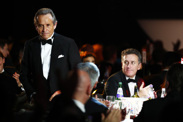 Jacky Ickx heads for the stage to accept a Gregor Grant Award
