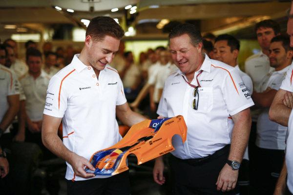 Zak Brown, Executive Director, McLaren Racing presents Stoffel Vandoorne, McLaren with a farewell gift from the team