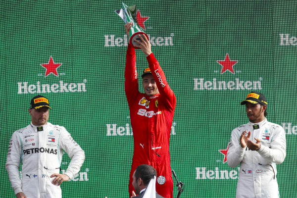 Valtteri Bottas, Mercedes AMG F1, Race winner Charles Leclerc, Ferrari and Lewis Hamilton, Mercedes AMG F1 celebrate on the podium with the trophy