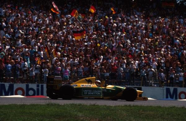 Michael Schumacher (GER) Benetton B192, waves to the German crowds after his first home Grand Prix.