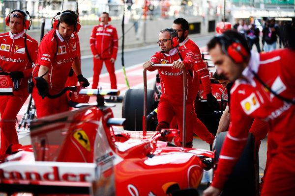 Silverstone, Northamptonshire, UK.  Friday 14 July 2017. Kimi Raikkonen, Ferrari SF70H, stops in his pit box behind Sebastian Vettel, Ferrari SF70H.  World Copyright: Andy Hone/LAT Images  ref: Digital Image _ONY5629