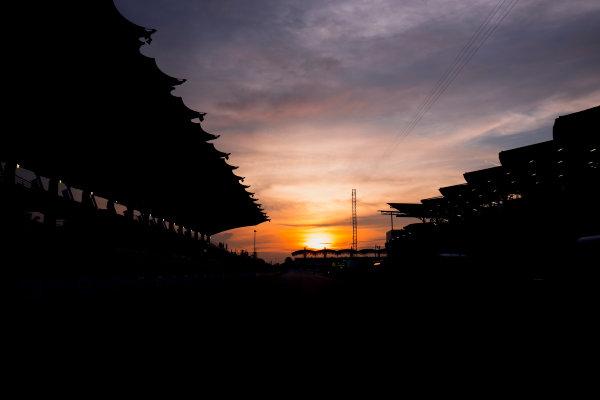 Sepang International Circuit, Sepang, Malaysia. Friday 29 September 2017. Sun rises at the Sepang Circuit. World Copyright: Zak Mauger/LAT Images  ref: Digital Image _56I2053