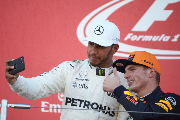 Suzuka Circuit, Japan. Sunday 8 October 2017. Lewis Hamilton, Mercedes AMG, 1st Position, takes a photo with Max Verstappen, Red Bull, 2nd Position, on the podium. World Copyright: Steve Etherington/LAT Images  ref: Digital Image SNE15047