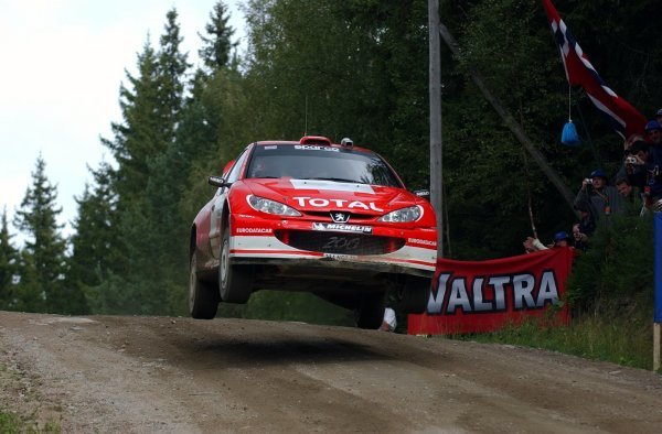 Richard Burns (GBR) gets airborne in his Peugeot 206 WRC.