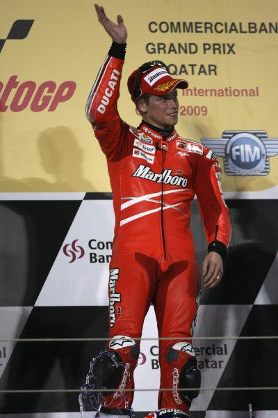 Qatar, Losail International Circuit.10th - 13th April 2009.Casey Stoner Marlboro Ducati Team celebrates on the podium.World Copyright: Martin Heath/LAT Photographicref: Digital Image BPI_Moto 7o61