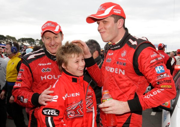 Garth Tander and Mark Skaife with son Mitchell after winning the  L&H 500, Tander Skaife win L&H 500 at the Phillip Island Grand Prix Circuit, Phillip Island, Victoria, September 14, 2008.