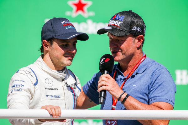 Interlagos, Sao Paulo, Brazil. Sunday 12 November 2017. Rubens Barrichello interviews Felipe Massa, Williams Martini Racing, on the podium. World Copyright: Charles Coates/LAT Images  ref: Digital Image AN7T7362