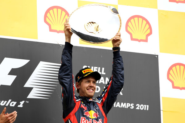 Spa-Francorchamps, Spa, Belgium28th August 2011.Sebastian Vettel, Red Bull Racing RB7 Renault, 1st position, on the podium. Portrait. Podium. World Copyright: Andy Hone/LAT Photographicref: Digital Image CI0C2487