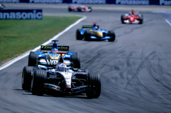 2004 German Grand PrixHockenheim, Germany. 23rd - 25th July.David Coulthard, McLaren Mercedes MP4/19 leads Fernando Alonso, Renault R24 and Jarno Trulli, Renault R24. Action. World Copyright:Lorenzo Bellanca/LAT Photographic Ref:35mm Image:A12