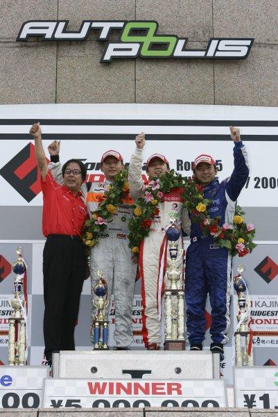 2006 Formula Nippon Championship Autopolis, Japan. 5th - 6th August 2006 Race podium - winner Tsugio Matsuda (mobilecast IMPUL) 1st position, Toshihiro Kaneishi (ARTA) 2nd position and Tatsuya Kataoka (Team LeMans) 3rd position. World Copyright: Yasushi Ishihara / LAT Photographic ref: Digital Image 2006FN_R5_010