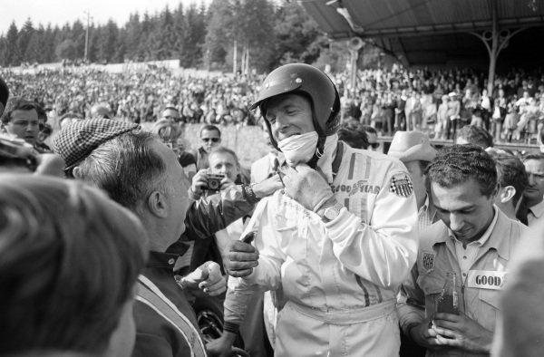 Dan Gurney, 1st position, celebrates victory. Jo Ramirez is stood beside.