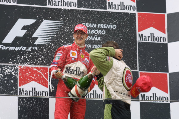 2001 Spanish Grand PrixCatalunya, Barcelona, Spain. 27-29 April 2001.Michael Schumacher (Ferrari) 1st position and Jacques Villeneuve (B.A R. Honda) 3rd position, celebrate on the podium.World Copyright - LAT Photographicref: 8 9 MB Digital File