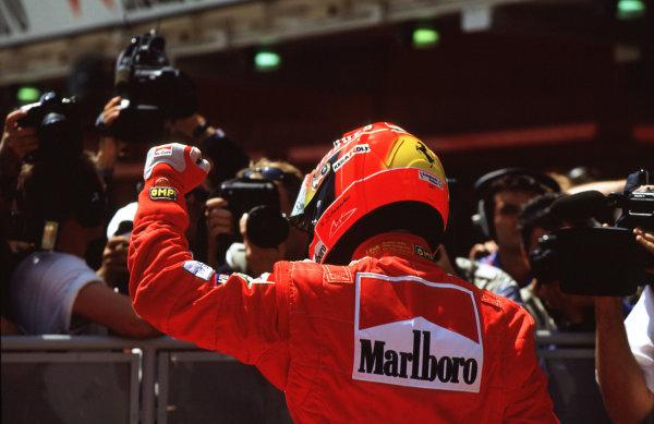 2001 Spanish Grand PrixCatalunya, Barcelona, Spain. 27-29 April 2001.Michael Schumacher (Ferrari) raises his fist in the air after winning the Spanish Grand Prix.World Copyright - LAT Photographicref: 35mm Image