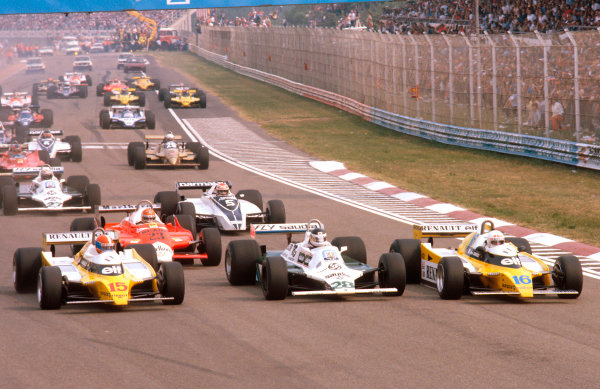 1980 Italian Grand Prix.Monza, Italy.12-14 September 1980.Rene Arnoux and Jean-Pierre Jabouille (both Renault RE20's) lead away at the start with Carlos Reutemann (Williams FW07B Ford) sandwiched in between. Behind Bruno Giacomelli (Alfa Romeo 179) is followed by Nelson Piquet (Brabham BT49 Ford).Ref-80 ITA 06.World Copyright - LAT Photographic