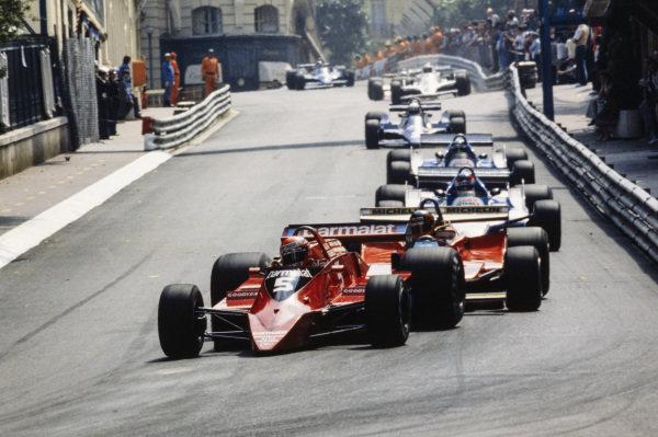 Niki Lauda, Brabham BT48 Alfa Romeo leads Gilles Villeneuve, Ferrari 312T4, Patrick Depailler, Ligier JS11 Ford and Jacques Laffite, Ligier JS11 Ford.