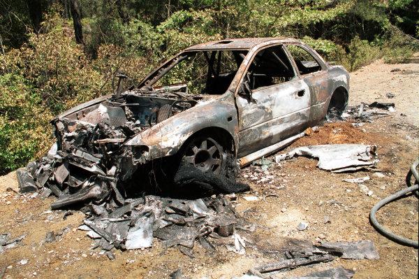 2001 Cyprus Rally.Hamed Al Wahaibi's burnt out Subaru Impreza WRC.Photo:McKlein.