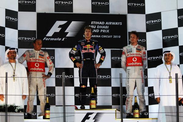 Podium (L to R): Second placed Lewis Hamilton (GBR) McLaren, race winner Sebastian Vettel (GER) Red Bull Racing and third placed Jenson Button (GBR) McLaren. Formula One World Championship, Rd 19, Abu Dhabi Grand Prix, Race, Yas Marina Circuit, Abu Dhabi, UAE, Sunday 14 November 2010.