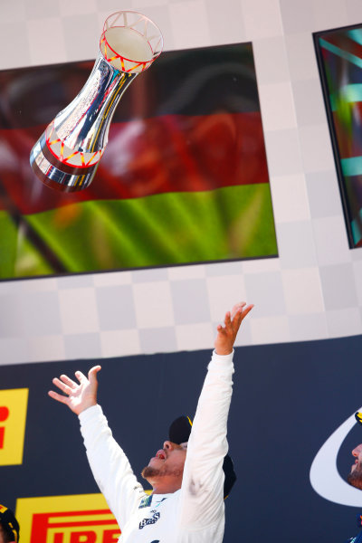 Circuit de Catalunya, Barcelona, Spain. Sunday 14 May 2017. Lewis Hamilton, Mercedes AMG, 1st Position, celebrates by tossing his trophy in the air. World Copyright: Andy Hone/LAT Images ref: Digital Image _ONZ6684
