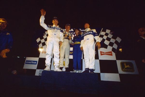 Sebring 12 Hours, Florida, USA. 16th March 1991. Rd 3. Geoff Brabham / Derek Daly / Gary Brabham (Nissan NPT-90), 1st position, podium, portrait.   World Copyright: Bill Murenbeeld/LAT Photographic. Ref:  91IMSA SEB 10.