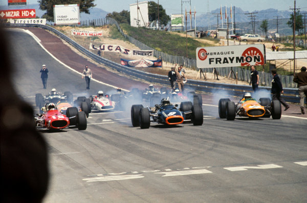 Jarama, Madrid, Spain. 10-12 May 1968. Poleman Chris Amon (Ferrari 312) is left behind by Pedro Rodriguez (BRM P133) and Denny Hulme (McLaren M7A Ford) at the start. Ref-68ESP02. World Copyright - LAT Photographic