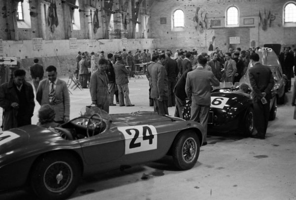The Ferrari 195S Barchetta of Luigi Chinetti / Pierre Louis-Dreyfus (#25), behind the Ferrari 166 MM of Porfirio Rubirosa / Pierre Leygonie (#26), and the Ferrari 195S Berlinetta Touring of Raymond Sommer / Dorino Serafini line up during scrutineering.