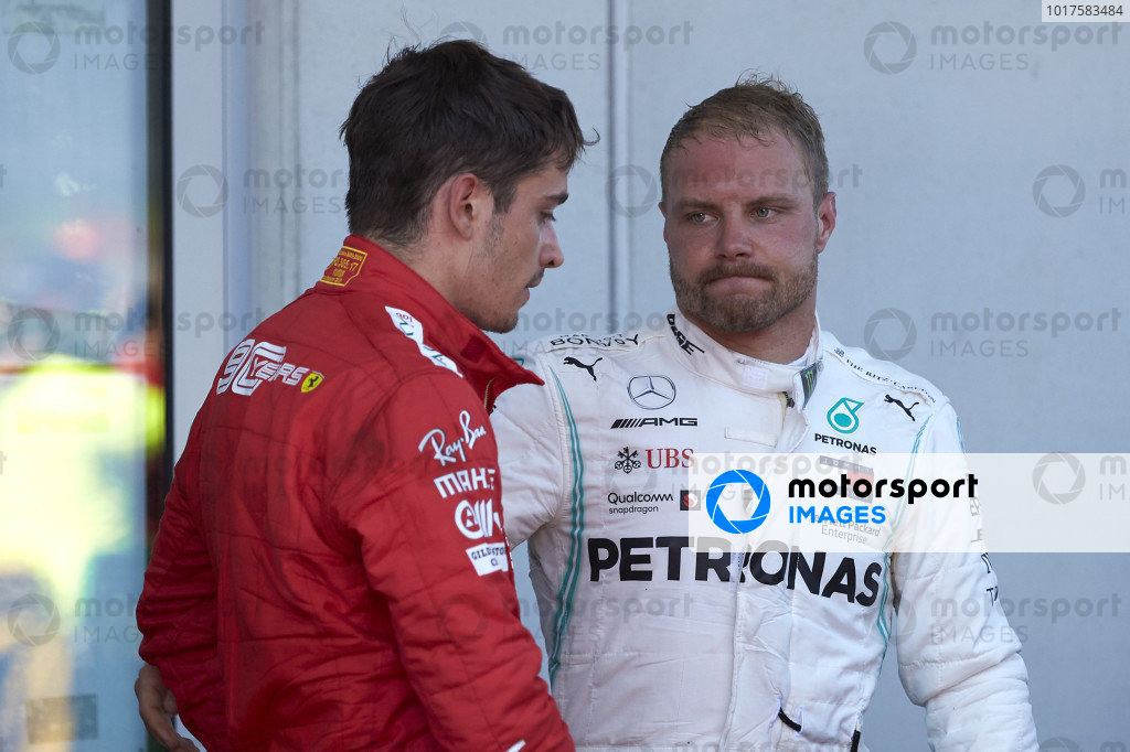 Charles Leclerc, Ferrari, 2nd position, and Valtteri Bottas, Mercedes AMG F1, 3rd position, congratulate each other in Parc Ferme