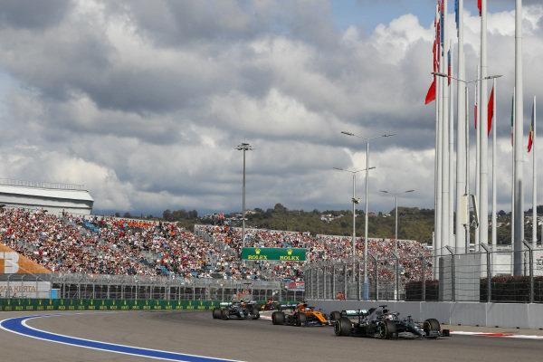 Lewis Hamilton, Mercedes AMG F1 W10, leads Carlos Sainz Jr., McLaren MCL34, Valtteri Bottas, Mercedes AMG W10 and Lando Norris, McLaren MCL34