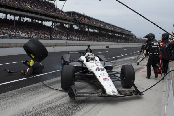 Jordan King, Rahal Letterman Lanigan Racing Honda, slides into pit box, striking tire, and injuring crewman