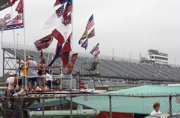 2002 NASCAR,Darlington Raceway,Aug 30-Sept 1 20022002 NASCAR, Darlington,SC. USA -Die-Hard fans watch practice in the overcast drizzling rain with the backdrop of empty stands,Copyright-Robt LeSieur2002LAT Photographic