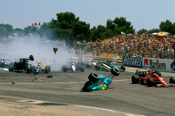 Paul Ricard, France.7-9 July 1989.Mauricio Gugelmin (March CG891 Judd) has a huge crash on the start of the race at Epingle Ecole. Rene Arnoux (Ligier JS33 Ford) flies up after crashing into Jonathan Palmer (Tyrrell 018 Ford) as well.Ref-89 FRA 09.World Copyright - LAT Photographic