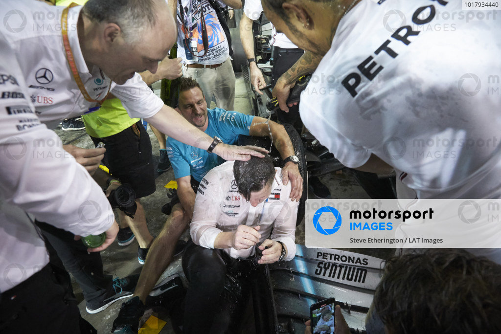 Peter Bonnington, Race Engineer, Mercedes AMG, is soaked by Lewis Hamilton, Mercedes AMG F1, 1st position, and his team in celebration