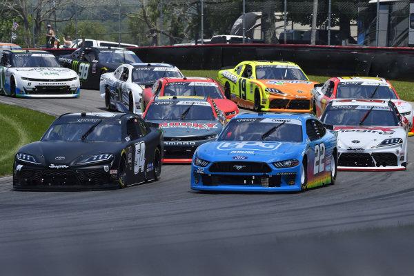 #54: Ty Gibbs, Joe Gibbs Racing, Toyota Supra Joe Gibbs Racing and #22: Austin Cindric, Team Penske, Ford Mustang PPG