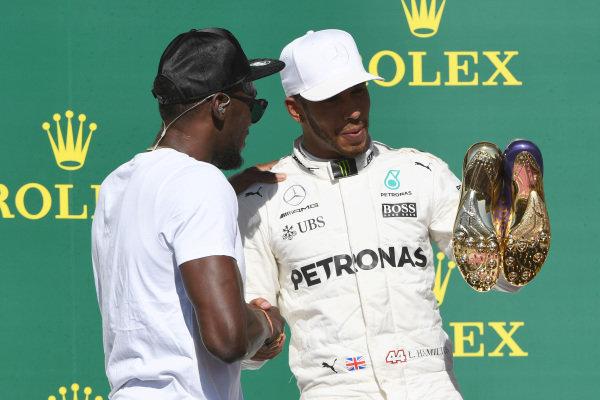 Race winner Lewis Hamilton (GBR) Mercedes AMG F1 celebrates on the podium with  Usain Bolt (JAM) at Formula One World Championship, Rd17, United States Grand Prix, Race, Circuit of the Americas, Austin, Texas, USA, Sunday 22 October 2017. BEST IMAGE